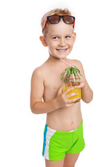 Adorable happy boy with juice on a white background