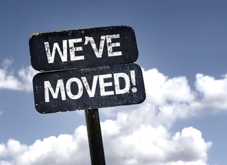 We've Moved! sign with clouds and sky background