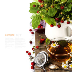 bouquet of wild strawberry with herbal tea and strawberry jam © Natalia Klenova