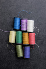 several spools of colorful thread