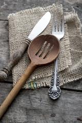 Cutlery strewn across a table.