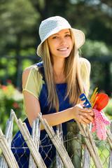 Happy woman  in uniform at yard gardening