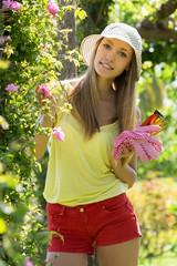 Smiling woman in yard gardening