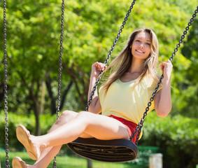 Girl on swing in summer