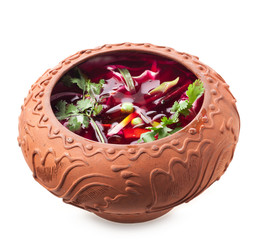 Ukraine cuisine, beet soup - borsch in ceramic pots isolated