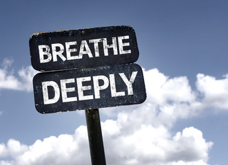 Breathe Deeply sign with clouds and sky background