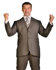 Joyful businessman raised his hands up