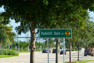 Vanderbilt Beach road sign with traffic