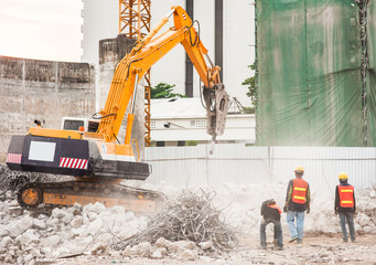 Excavator and Workers Working on Construction Site