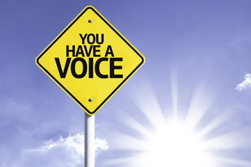 You have a Voice road sign with sun background