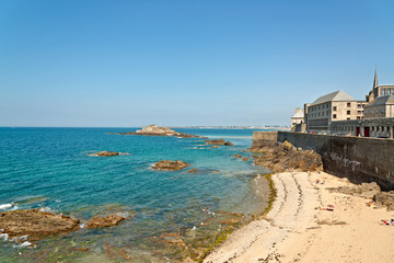 Beach of Saint Malo in summer with tourists and blue sky. Britta