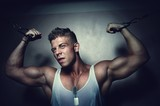 Guy trains his pecs using crossover poster