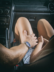 Male hand touches the female knee.