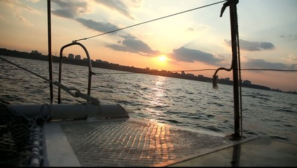 View from deck of a yacht on the sea in sunset time