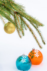 Christmas balls and green fir branch on snow background