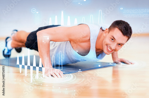 canvas print picture smiling man doing push-ups in the gym