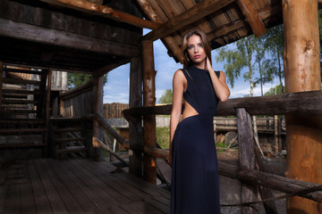 Awesome woman posing on log house