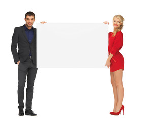 couple holding big blank white board