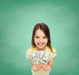 smiling little girl with dollar cash money