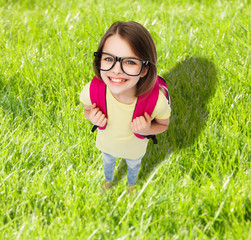 happy smiling teenage girl in eyeglasses with bag