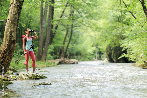canvas print picture Young woman hiking in the forest