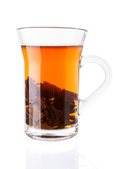 Hot Tea with Tea Leaves in Glass Cup