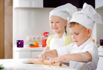 Little girl and boy making homemade pizza