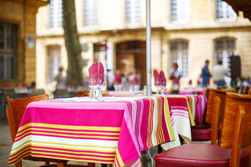 Street view of a cafe terrace with empty tables and chairs, Prov
