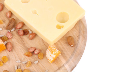 Cheese with raisins and nuts on platter.