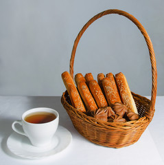 Basket with bread and sweet and tea