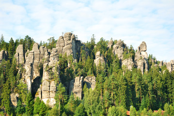 Adrspach rock town sandstone towers with green forest trees
