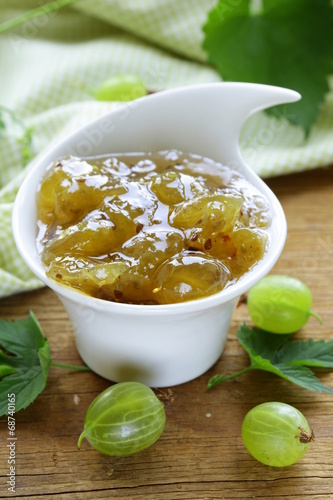 Green gooseberry jam on a wooden table - 68740165