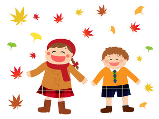 A girl and a boy standing happily in autumn leaves