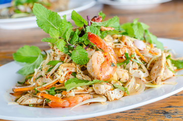 Thai Spicy salad with chicken, shrimp, fish and vegetables