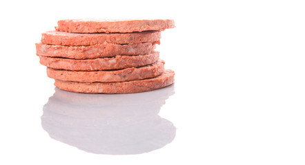 Frozen raw hamburger beef meat over white background