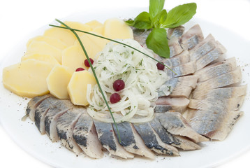plate of herring on a white background