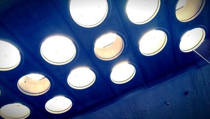 Round light windows in concrete ceiling