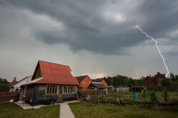 Lightning over the houses