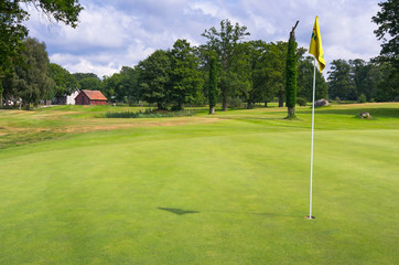 Green field with flag on Swedish golf course