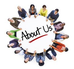 """Multiethnic People in Circle with """"About Us"""" Concept"""