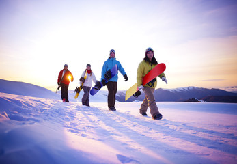 People On Their Way To Snow Boarding