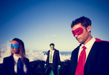 Business superheroes on the beach