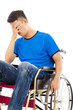 depressed and handicapped man sitting on a wheelchair