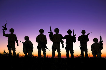 silhouette of  Soldiers team with sunrise background