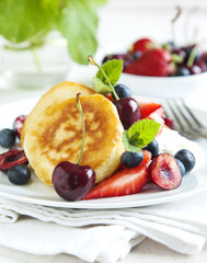 Homemade pancakes with fresh fruits salad and yogurt