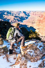 Hiker looks into depth of Grand Canyon before going on the trail