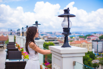 Young beautiful woman on restaurant terrace with stunning view