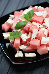 Salad with watermelon cubes, feta cheese and fresh mint leaves