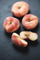 Ripe chinese flat peaches, close-up, studio shot