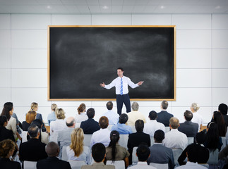 Businessman Giving Presentation in Board Room